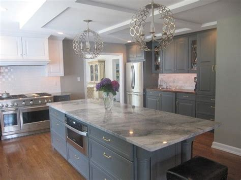 White And Grey Countertops by White Quartzite With Gray Cabinets Modern Kitchen
