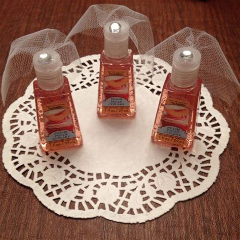 Cute Giveaways - hand sanitizer with little tule veils for bridal shower favors so cute bridal