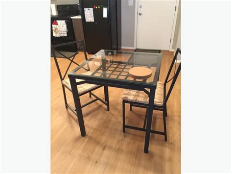 ikea glass top kitchen table and two chairs east regina