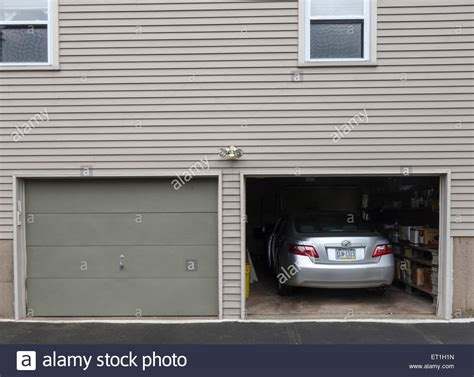 Unlock Garage Door From Inside Open Garage Door With Car Parked Inside American Style Wooden House Stock Photo Royalty Free
