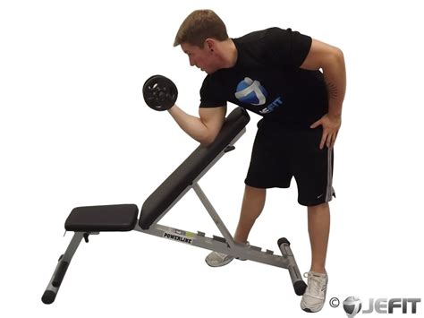 exercises using a bench dumbbell standing one arm curl over incline bench