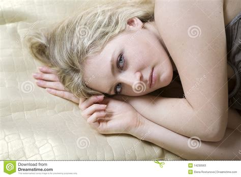 lying on the bed blond teen girl lying on bed stock photos image 14230563