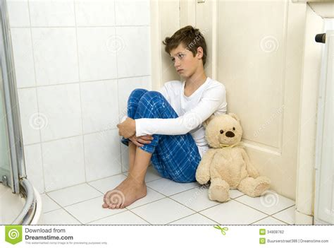 boys in the bathroom sad and depressed boy in corner stock photography image