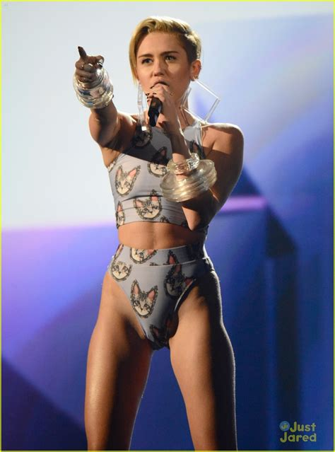 miley cyrus shuts down the amas with her lip synching miley cyrus wrecking ball at amas 2013 watch now