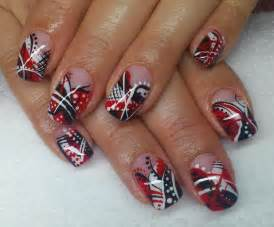 Red black and white polish in combination with lines dots and many