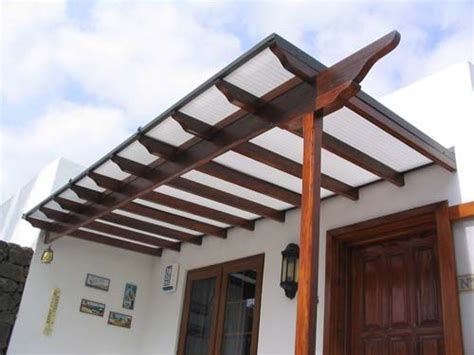 walled pergola with polycarbonate roof back garden