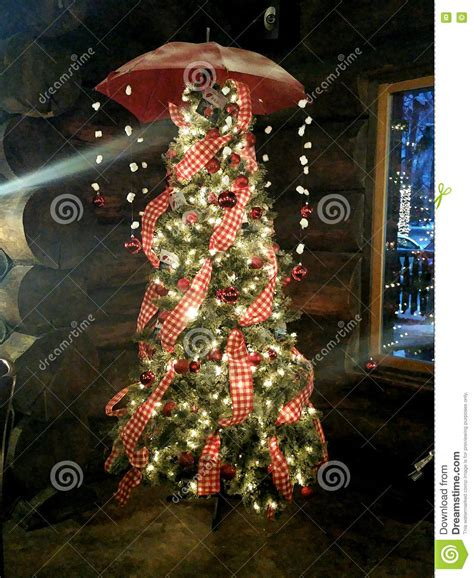 christmas lights that hang down colorfully decorated christmas tree with umbrella and