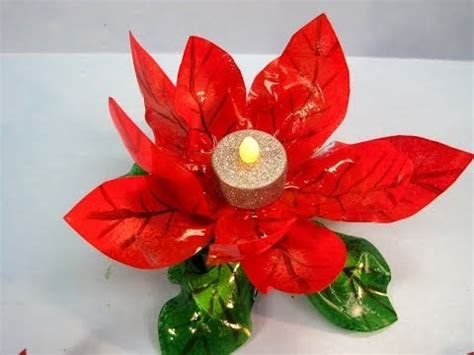 dwell beautiful shows you how to reuse candle jars and wax recycled poinsettia candle holder featuring miriam joy