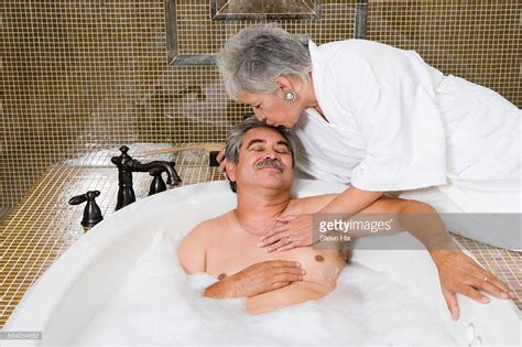 my wife in bathroom wife kissing husband in bath tub stock photo getty images