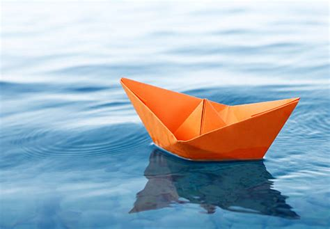 Paper Boats - paper boat pictures images and stock photos istock