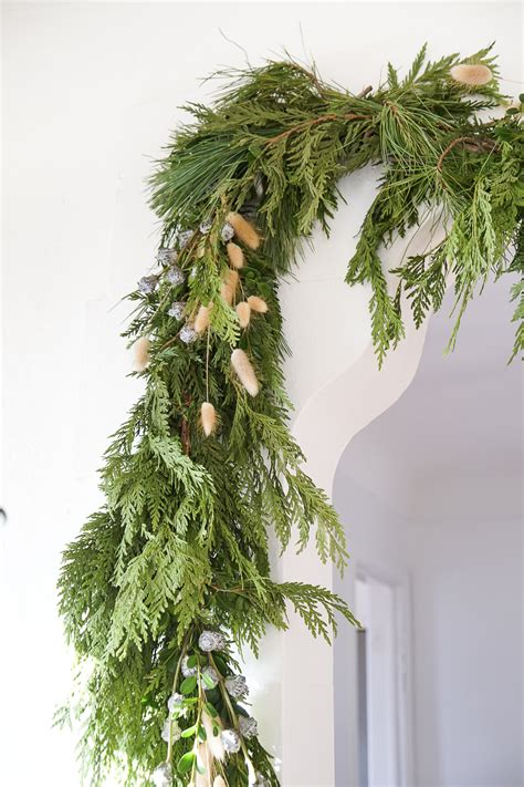 how to hang garland on christmas tree how to hang heavy garland without damaging your walls francois et moi