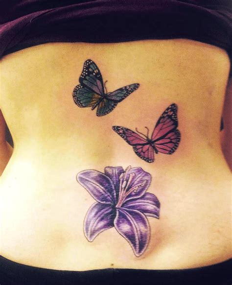 butterfly tattoo on back 28 awesome butterfly tattoos with flowers that nobody will