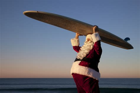 santa on surfboard time to ponder the year that was 26 238230 3b andrew griffiths enterprises