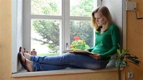sitting window sitting on window sill end reading book it stock footage videoblocks