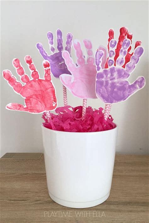 crafts using handprints handprint flower craft for housing a forest