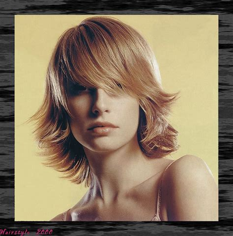 bang flip haie styles medium layered hair style with wispy side part bangs flip