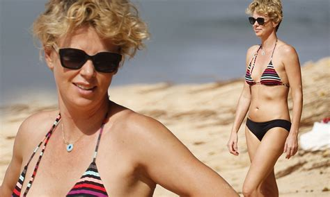 charlize theron shows   enviable bikini body