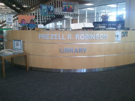library reception desk flat cut aluminum lettering for st aug s library