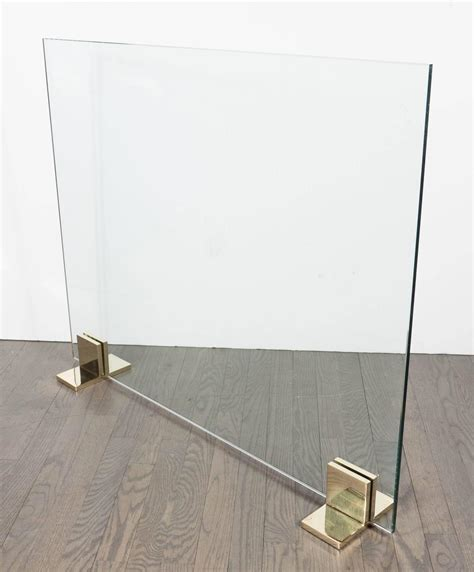 custom modern screen in polished brass and tempered