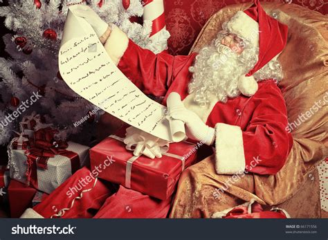 img of santa claus and x mas tree santa claus with presents and new year tree at home stock photo 66171556