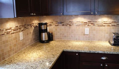 2x2 ceramic tile with linear border backsplash designs