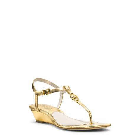 michael kors gold wedge sandals michael kors nora metallic leather wedge sandal in gold lyst
