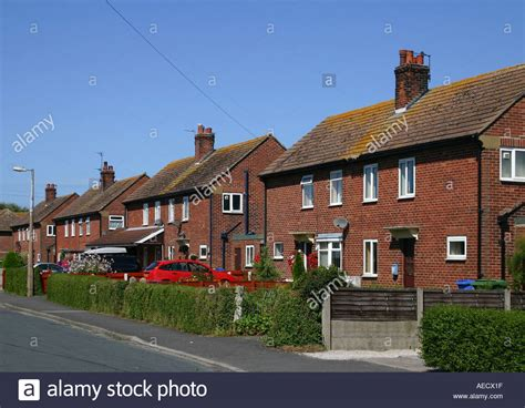 semi detached house or row house row of old semi detached red brick council houses stock