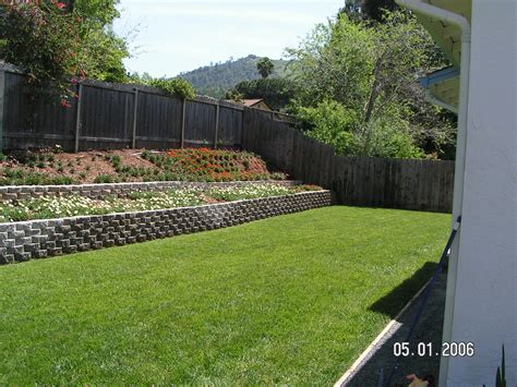 backyard slope ideas retaining wall slope down to flat backyard garden yard