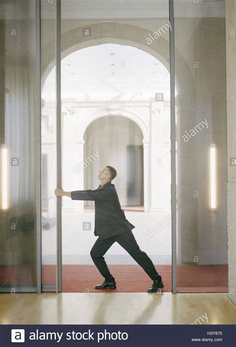 sliding glass door to open office buildings businessman sliding door open push
