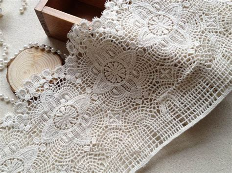 pattern of vintage crochet lace in an ecru color beige crocheted antique lace ecru cotton lace trim retro