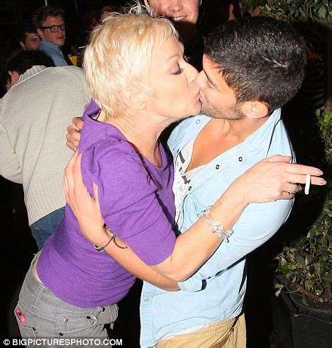 denise welch kisses pal after night carousing at a dancing