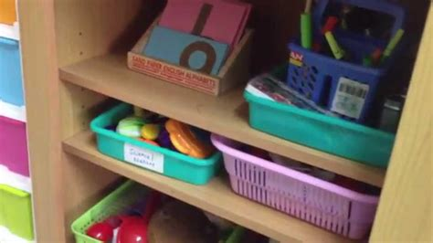 how to set up a montessori inspired shelf at home for