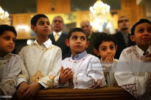 Egyptian coptic christian boys participate in the celebration of
