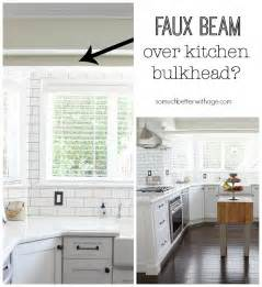 Wooden Kitchen Island faux beam over kitchen bulkhead wood beam inspiration