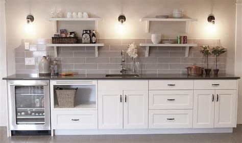 bar cabinet with sink and fridge white and gray basement wet bar features white cabinets