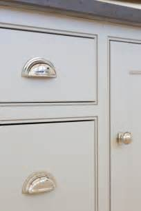 Kitchen Cabinet Door Handles And Knobs Grey Kitchen Cabinetry And Polished Nickel Handles At The