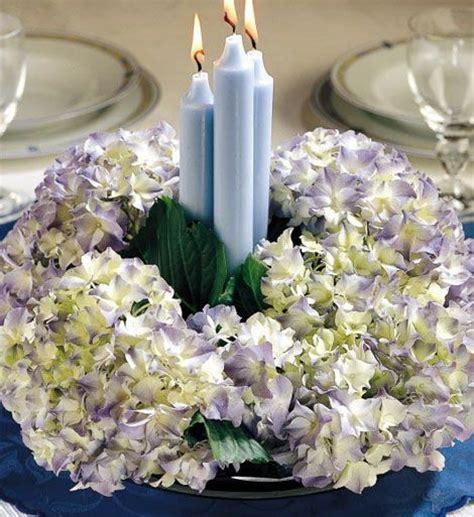composizioni candele e fiori centrotavola ortensie e candele centrotavola