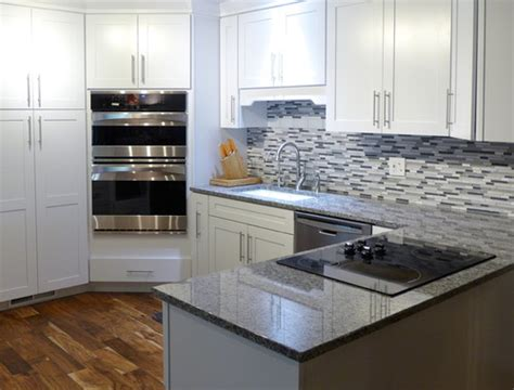 new caledonia granite white cabinets new caledonia white cabinets backsplash ideas
