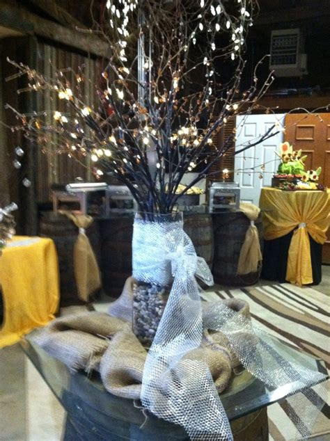 rustic centerpiece with buffet set up in background