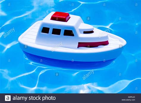 toy boat ocean toy cruise ship floating in swimming pool stock photo