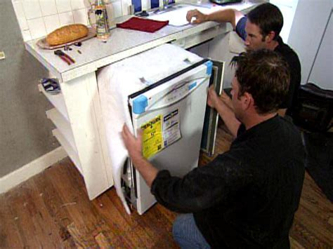 how to put up kitchen cabinets how to install upper how to remove and replace a dishwasher how tos diy