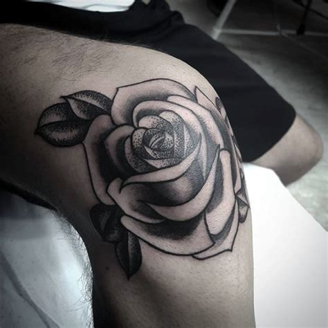 rose knee tattoo traditional school style flower with leaves black