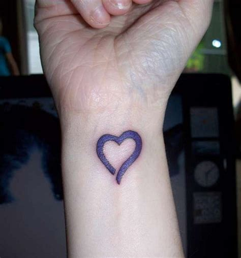 heartbeat tattoo on wrist meaning heart tattoos on wrist designs ideas and meaning