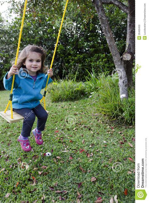 little girl on swing little girl on a swing stock photo image 26469450