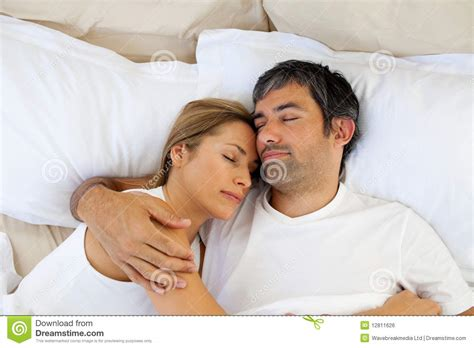 what to do in bed caring lovers sleeping lying on the bed royalty free stock
