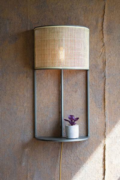 wall sconce light  rattan shade  metal shelf