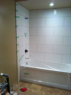 wall tile bathroom remodel   white tile shower bathtub tile white bathroom