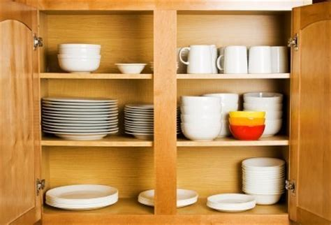 How To Organize Dishes In Cabinets by Organizing Kitchen Cabinets Thriftyfun
