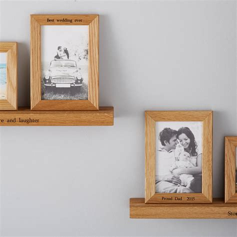 personalised multi photo frame shelf with two frames by