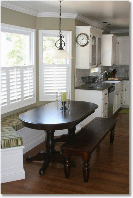 built in kitchen table under window and the kitchen